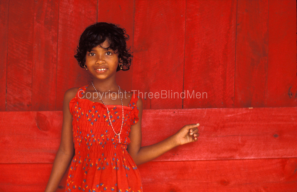 Girl in red dress with blue detail.<br /> Sri Lanka