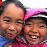 School playground. Coastal Inuit community of Arctic Bay. Lancaster Sound. HIgh Arctic. Baffin Island. .(people, children, kid, girl, boy, teen, cute, playing, class, break ,