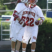 Denver Midfielder Max Planning (22) celebrates with teammate Denver Midfielder Colin Woolford (57) in the second half of The NCAA Division I Men's Lacrosse Tournament game between the No. 5 seed Denver and No. 12 ranked Drexel Sunday, May. 18, 2014 at Delaware Stadium in Newark, DEL