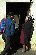 Campesino man and woman entering a home in Tarabuco, Chuquisaca, Bolivia