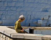 An orthodox Jewish child reads a book. Zefat, Israel.