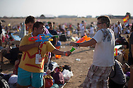 Pilgrims play with water guns while waiting for Pope Pope Benedict XVI at the base of Cuatro Vientos, eight kilometres (five miles) southwest of Madrid on August 21, 2011.The pilgrims spent the night in the open air at the base of Cuatro Vientos, eight kilometres (five miles) southwest of Madrid, where Pope Benedict XVI celebrates the closing mass of the August 16-21 youth festival on Sunday morning