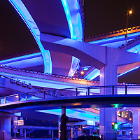 China, Shanghai, Overlapping concrete overpasses of Yan An Elevated Highway on rainy spring evening