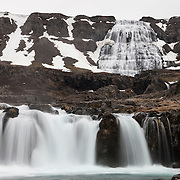 Dynjandi is a series of waterfalls that together drop more than 100 meters (330 feet) in Iceland's Westfjords. Shown here are Bæjarfoss (in the foreground) and Hæstajallafoss.