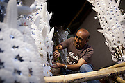 Pedro Alarcon builds a religious float using traditional wax ornaments in Ayacucho, Peru during Holy Week.<br />