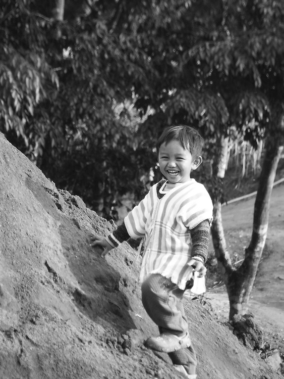 The Pure Smile, Thailand, by Nukul. <br /> <br /> About the photographer: Nukul is now 27 years old. She has a baby who called Nu Nu and he is 3 years old. Nukul is from Pong Lam Rang, a Karen village in the mountainous Mae Wang district of northern Thailand. She travels home to her native village as often as she can in order to visit her family. She would love to travel to many places on Earth to take beautiful pictures. <br /> Nukul enjoyed her experience with &lsquo;Lensational&rsquo; that gave her the opportunity to take a camera back to her village and take shots of her son and the things that she experienced. Through the lens she discovered the love of cobalt blue, white and black. She learnt how to use various stylistic filters, such as Tilt-Shift which she is now able to select critically when approaching her subjects.