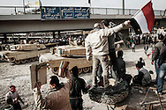 After days of clashes, anti Mubarak demonstrators facing Egyptian President's supporters near Tahir square with army M-1 battle tanks standing between the groups. 03 February 2011.