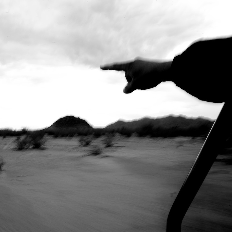 Bobby Parra points while riding through the desert on Sunday, July 13, 2008 in North Komelik, AZ.