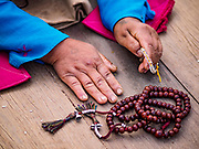 17 MARCH 2017 - KATHMANDU, NEPAL: A woman's hands and prayer beads during morning prayers at Boudhanath Stupa in Kathmandu. The stupa is the holiest site in Nepali Buddhism. It is also the center of the Tibetan exile community in Kathmandu. The Stupa was badly damaged in the 2015 earthquake but was one of the first buildings renovated.     PHOTO BY JACK KURTZ