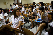 "Wittaya Jannoi (21) in class. He is a marketing student and hopes to change his gender after he .finishes his studies at Suan Dusit university.  He sais: ""I'm happy here. We can be ourselves .because we don't have to hide. My mother said, 'Graduate first, then you can do what you .want'."" Like many transgender students, he learnt about the university through the beauty .pageant. ""I couldn't wait to come here."".In Suan Dusit University in Bangkok, ladyboys feel free to be themselves by getting dressed in .girls' uniforms and behaving in a feminning way. The University's policy of accepting them as .equal to other students, has made it so popular that it now has about 100 transgender .students studuing in it's faculties."