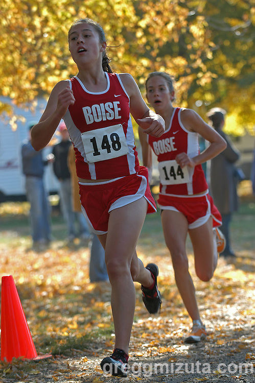 Boise junior Jacque Sahlberg and freshman Katie Lovelace on the final stretch during the Idaho High School Cross Country State 5A Girls Championships at Hells Gate State Park in Lewiston, Idaho on October 29, 2006. Salhberg finished fourteenth (20:05.03) and Lovelace sixteenth (20:09.01). ..Boise won the team title (46), followed by Eagle (79) and Twin Falls (102). Boise team members were Sarah Olson, Anne Lovelace, Rebekah McGourty, Jacque Salhberg, Katie Lovelace, Amanda Mosher, and Fiona Wilhelm. Coaches were Dave Mills and Kathy Olson.