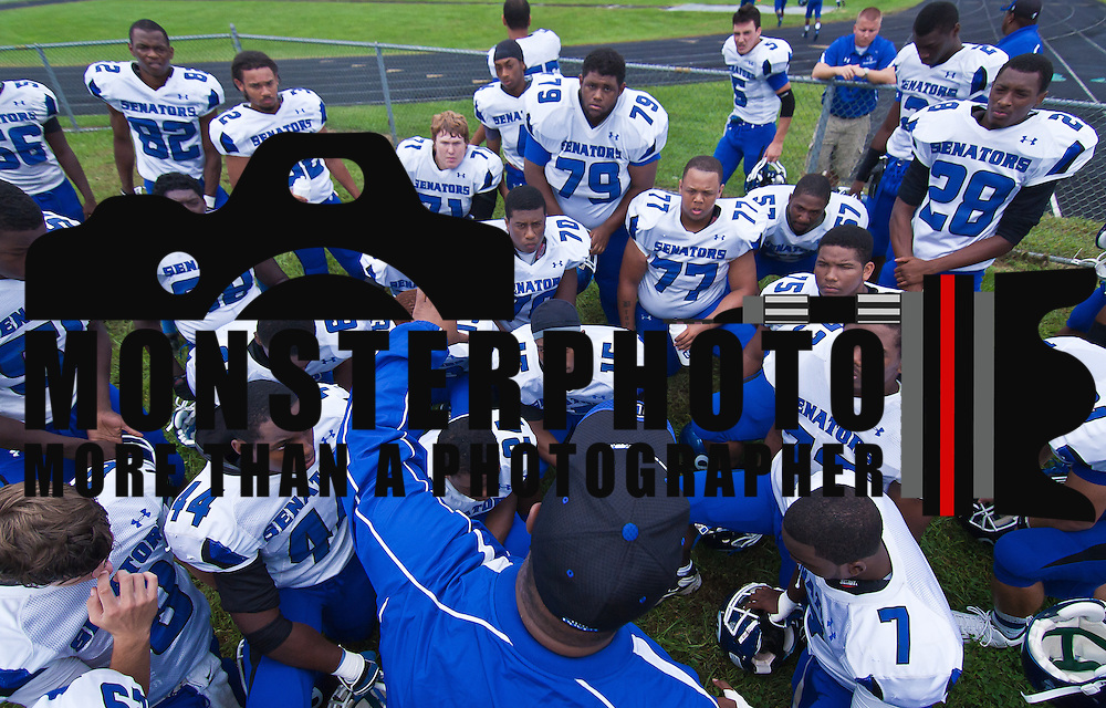 Dover head coach Carlton Brown giving his team a per game prep talk prior to a Week 3 high school football game against St. Mark's Saturday afternoon Sept. 24, 2011 in Wilmington DE. ..The News Journal/Saquan Stimpson