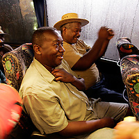 NEW ORLEANS, LA - September 4, 2005:  Evacuees from New Orleans were being flown to the city's airport via helicopter and unloaded on the tarmac. Unloaded on the tarmac in a scene similar to that of a war zone evacuation, they were then hustled from the helicopter onto waiting cargo carts ( normally used to move luggage) and rushed amid a throng of volunteers and into the airport where they received medical attention. Shortly after entering the airport, evacuees were screened and divided nto groups of 50 and told to go to a certain boarding gate. Evacuees only find out the destination of the flight, and their new temporary home, after boarding the flight. (Photo by Todd Bigelow/Aurora)..Chaney family arrives in West Palm, Beach, Florida. Anthony, foreground, and Kenneth are excited to hear they will be receiving cell phones, have a new apartment, clothes and help for the next two months at a private complex in Boynton Beach, Florida.......Members of the Chaney family, Kenneth (large man with straw hat), Anthony (other man with shorts), Elaine (younger woman), and Julia (woman with MLK prayer fan and hat--she's Ken's and Anthony's mother). Joseph (yellow shirt,using cane to walk) and Velma (red shorts and white ball cap). Joseph and Velma are Elaine's parents...... (Last name TK--check with reporter ken lee)..