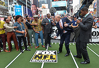 Terry Bradshaw dances after Bruno Mars  (in jean jacket and sunglasses)  confirmed that he will play during the Pepsi Super Bowl XLVIII Halftime Show at MetLife Stadium in East Rutherford, NJ on Sunday, February 2, 2014. He did this in New York City on the Fox NFL Sunday Program. / Russ DeSantis / AP Images for National Football League