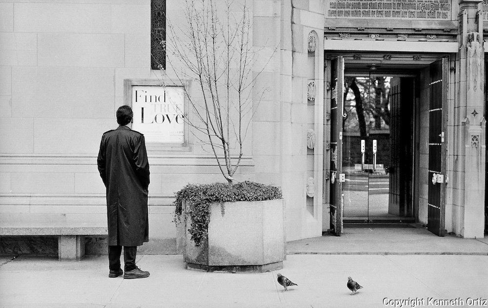 A man on 5th Avenue in New York in front of a church.