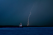 WI00184-00...WISCONSIN - Lightning storm during sunrise at Wisconsin Point Lighthouse on Lake Superior near the town of Superior.
