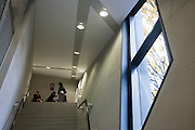 Young women in stairwell in the Graduate Centre at London Metropolitan University's Holloway Road campus.