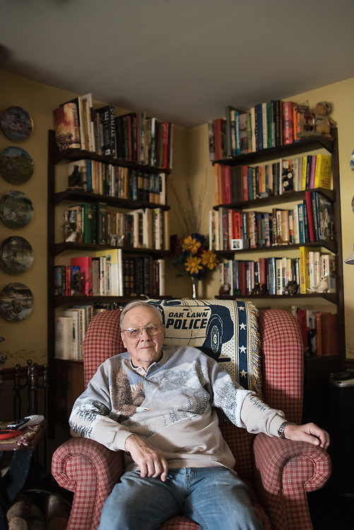 Retired Oak Lawn Police Det. Frank Gilbert poses for a portrait in his Oak Lawn home on April 11, 2017.