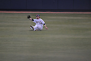 Ole Miss' Tanner Mathis (12) makes a diving catch against Alabama at Oxford-University Stadium in Oxford, Miss. on Friday, March 18, 2011. Ole Miss won 4-0. The Rebels are 15-4 on the season and 1-0 in SEC play.  (AP Photo/Oxford Eagle, Bruce Newman)
