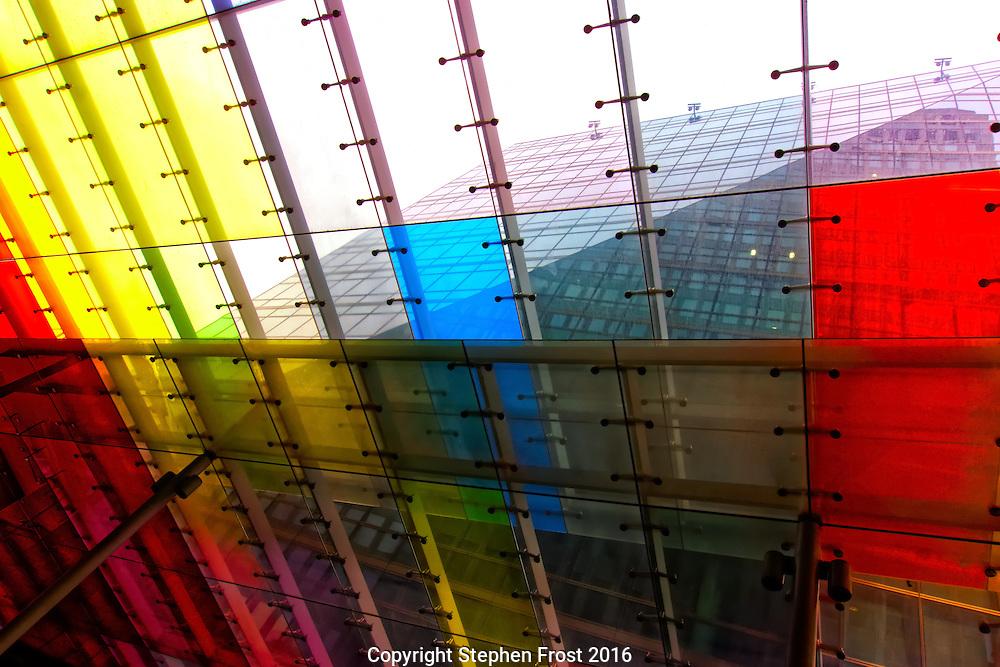 London skyline through coloured glass windows.