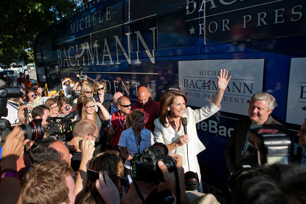 Republican presidential hopeful Michele Bachmann speaks to supporters and media outside her campaign bus after winning the Iowa Republican Straw Poll on Saturday, August 13, 2011 in Ames, IA.