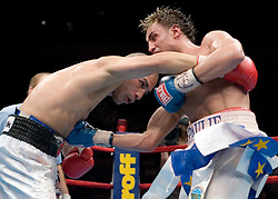 June 10, 2006 - New York, NY - WBO Champion Miguel Cotto (l) and Paulie Malignaggi trade punches during their 12 round Junior Welterweight Championship bout at Madison Square Garden.  Cotto retained his title via 12 round unanimous decision.