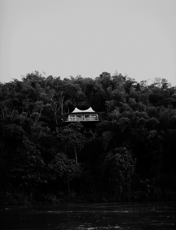 A tented bungalow at the Four Seasons Golden Triangle resort hovers above the Ruak River separating Thailand and Burma