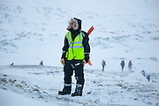 UNIS student Stephen Jennings stands on the windswept surface of Rabotbreen, Svalbard on a class field trip.