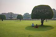 A couple sits under the shad eof a tree in New Delhi India, Sunday, Nov. 15, 2015. (AJ Mast)