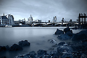 Long exposure shot of St. Paul's Cathedral and the skyline of the City of London, taken from the South Bank at low tide