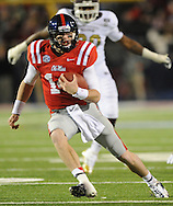Mississippi quarterback Bo Wallace (14) runs against Mississippi State at Vaught Hemingway Stadium in Oxford, Miss. on Saturday, November 24, 2012. Mississippi won 41-24. (AP Photo/Oxford Eagle, Bruce Newman).