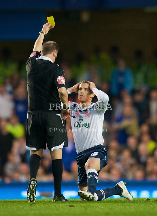 LONDON, ENGLAND - Wednesday, April 22, 2009: Everton's Phil Neville is shown the yellow card by the referee during the Premiership match against Chelsea at Stamford Bridge. (Pic by David Rawcliffe/Propaganda)