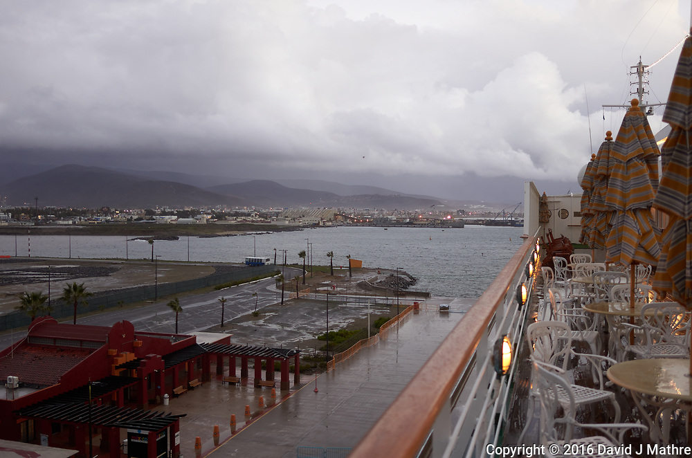 "(Image eight of nine) Panorama of the Ensenada harbor in Mexico on a grey and raining day from the deck of the MV World Odyssey. The other cruse ship is the Carnival Imagination. Once all of the students, faculty, staff, and life long learners were aboard we would be ready to begin the 102 day ""round the world"" Semester at Sea Spring 2016 Voyage. Composite of nine images taken with a Leica T camera and 23 mm f/2 lens (ISO 250, 23 mm, f/2, 1/80 sec). Panorama stitched using AutoPano Giga Pro."