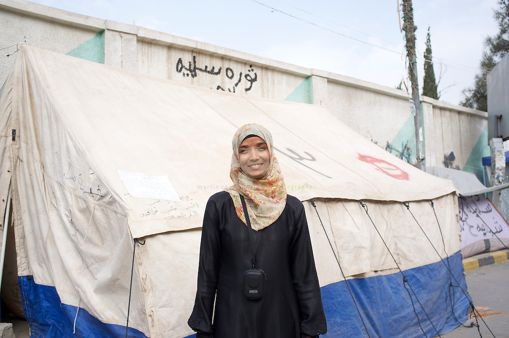 Turmoil in Yemen: ASIA, YEMEN, SANA, 22.06.2011: Anti-government activist Reem al-Gaifi in front of her family tent set up near Change Square in Sana, Yemen's capital. For months, protesters of all colors have been staying in tents at Change Square, demanding the resignation of President Ali Abdullah Saleh and an end to his regime.