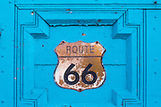 Route 66 sign on blue door in Old Town Albuquerque, New Mexico.