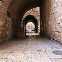 A narrow covered passageway into a courtyard in the Jewish Quarter of the Old City of Jerusalem.