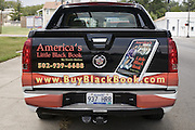 Author Norris Shelton's truck promotes his book outside the First Church of American Slaves at 314 Dr. W. J. Hodge Street, Sunday Aug. 7, 2011 in Louisville, Ky. (Photo by Brian Bohannon)