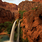 Mighty Havasu Falls tumbles over a limestone cliff in Havasu Canyon within the Grand Canyon, AZ.
