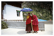 GAR MIGYUR RINPOCHE the 8th was born in 1939, in Nangchen County, Kham Province. He became a monk when he was five years old. During Chinese Cultural Revolution, he suffered great pain and endured humiliation. After his release, he took charge of the Gar-Gön Monastery. Together with Garchen Triptul Rinpoche, he reconstructed the existing retreat center and main monastery. The monastery now can hold up to two hundred monks and Gar Mingyur Rinpoche is the abbot of Gar-Gön Monastery. The abbot of Gargon and Khenpo La pose for a photo outside of Garchen Rinpoche's dwelling place at the monastery.