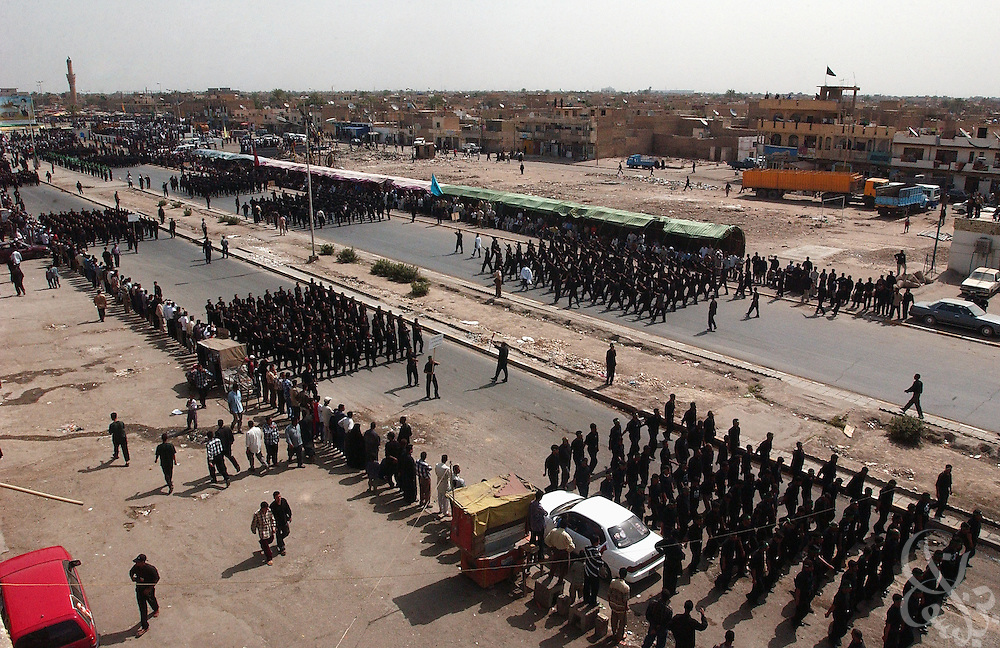 Members of the al-Mehdi Army  march in formation during an April 03, 2004 military parade through the streets of the Sadr City neighborhood in east Baghdad, Iraq.  ....