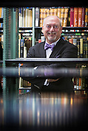 Recently hired Wisconsin University Press Director Dennis Lloyd poses for a portrait in the Wisconsin Memorial Library, Thursday, July 16, 2015.