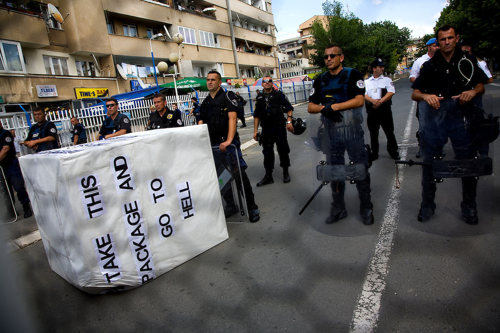 Vetvendosje (&quot;Self-Determination&quot; in Albanian) protest. Demonstration of throwing a package back to the UN, over a security fence toward UN riot police at UNMIK headquarters.<br /> <br /> Pristina, Kosovo, Serbia