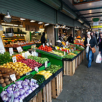 WA09564-00...WASHINGTON - Fruit and vegetable stand at the Pike Place Market in Seattle.