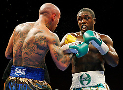 Jan 17, 2009; Biloxi, MS, USA; Andre Berto (green trunks) and Luis Collazo (gold trunks) fight on HBO's Boxing After Dark at the Beau Rivage Casino.