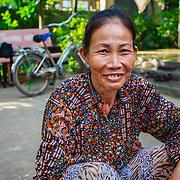 CAPTION: Bui Huong, outside her house. LOCATION: Long Tuyen, Can Tho, Vietnam. INDIVIDUAL(S) PHOTOGRAPHED: Bui Huong.