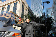 UK. London. Alan Vann, a Driver for Addison Lee which offers a limousine service for businessmen in London..Photograph shows Alan with his bike and customer, Rakesh Nigam..Photo©Steve Forrest/Workers' Photos