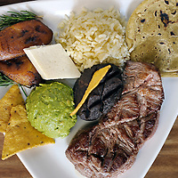 Antigua Guatemala, Guatemala 25 May 2008<br /> A &quot;Plato Tipico&quot;, typical Guatemalan lunch made by the Chef Bernabe Sanchez in El Meson restaurant. This meal is made of: white rice, frijoles volteados, guacamole, fresh cheese, steak, tortillas and  fried banana. <br /> Photo: Ezequiel Scagnetti