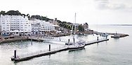 The Royal Yacht Squadron (top right) at the entrance to the Medina River in Cowes on the Isle of Wight. The famous club is 200 years old in 2015.<br /> The pontoon in the foreground is Trinity Landing.<br /> Picture date: Monday August 17, 2015.<br /> Photograph by Christopher Ison &copy;<br /> 07544044177<br /> chris@christopherison.com<br /> www.christopherison.com