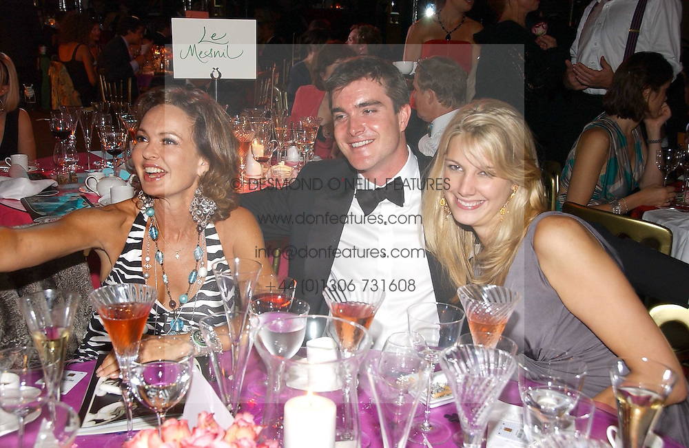 Left to right, COUNTESS MAYA VON SCHONBURG, LORD JAMES RUSSELL and CAMILLA VON STAUFFENBERG at the party Belle Epoque hosted by The Royal Parks Foundation and Champagne Perrier Jouet held at the Lido Lawns of the Serpentine, Hyde Park, London on 14th September 2006.<br />