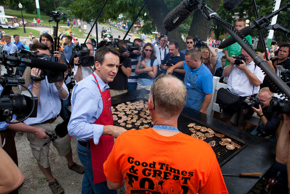 Republican presidential hopeful Tim Pawlenty flips pork sliders at the Iowa Pork Producers booth at the Iowa State Fair on Friday, August 12, 2011 in Des Moines, IA.